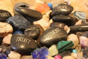 black rocks imprinted with words trust harmony hope