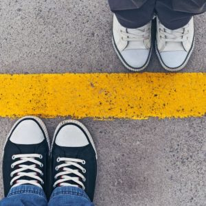 two pairs of shoes illustrating keeping healthy boundaries